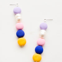 Navy Multi: Earrings with colorful clay beads stacked in a row mixed with one pearl bead