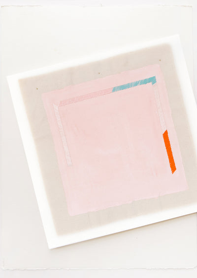 A minimalist abstract print of a pale pink square with small sections of blue, white, and red near its edges.