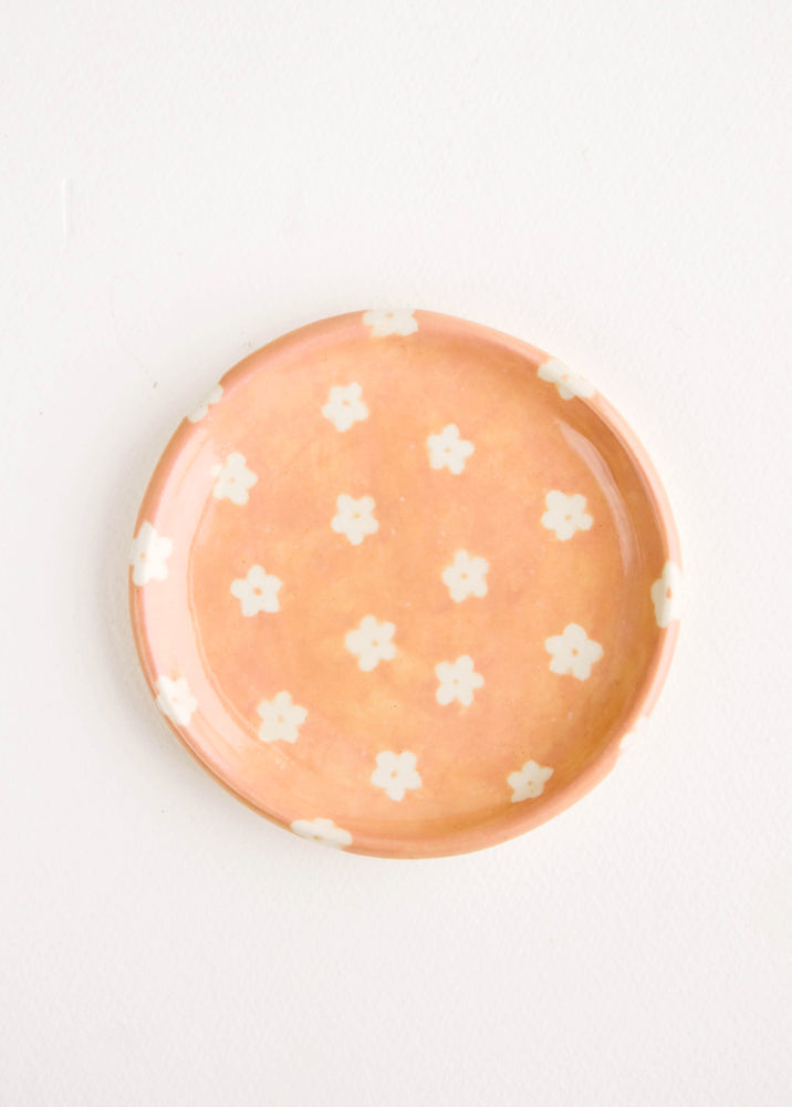 Peach Floral: Small, round ceramic dish in peach with small white flowers