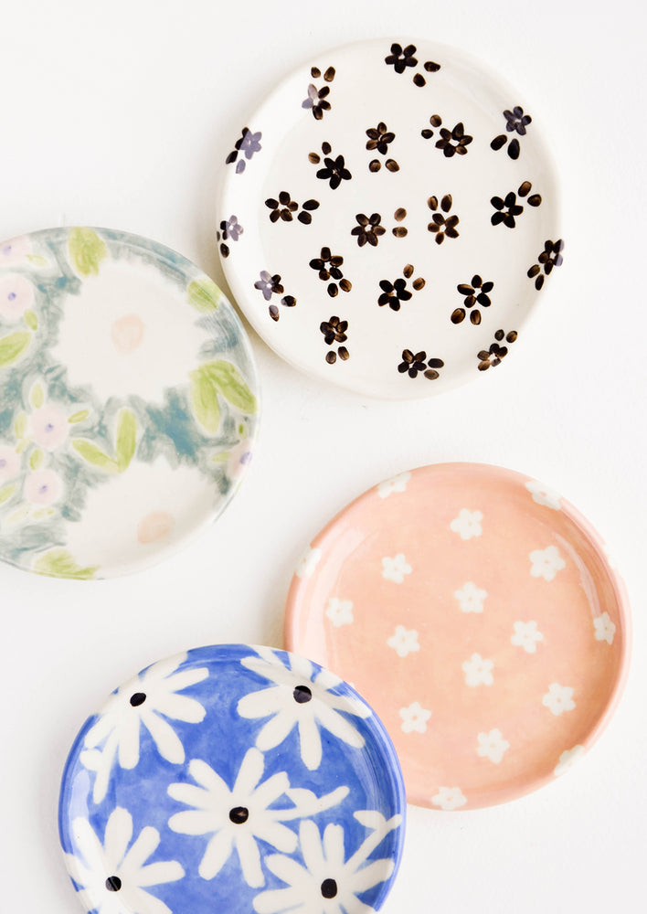 3: Round ceramic jewelry dishes in a mix of floral patterns
