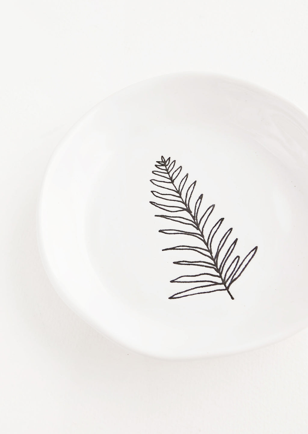 Fern: A round white ceramic dish with a single etched image of a fern in black.
