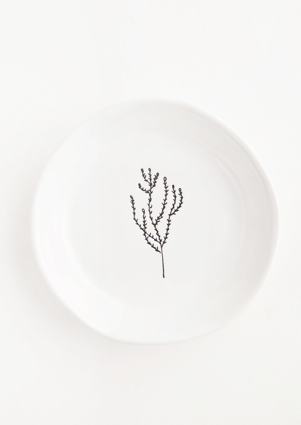 Seaweed: A round white ceramic dish with a single etched image of seaweed in black.