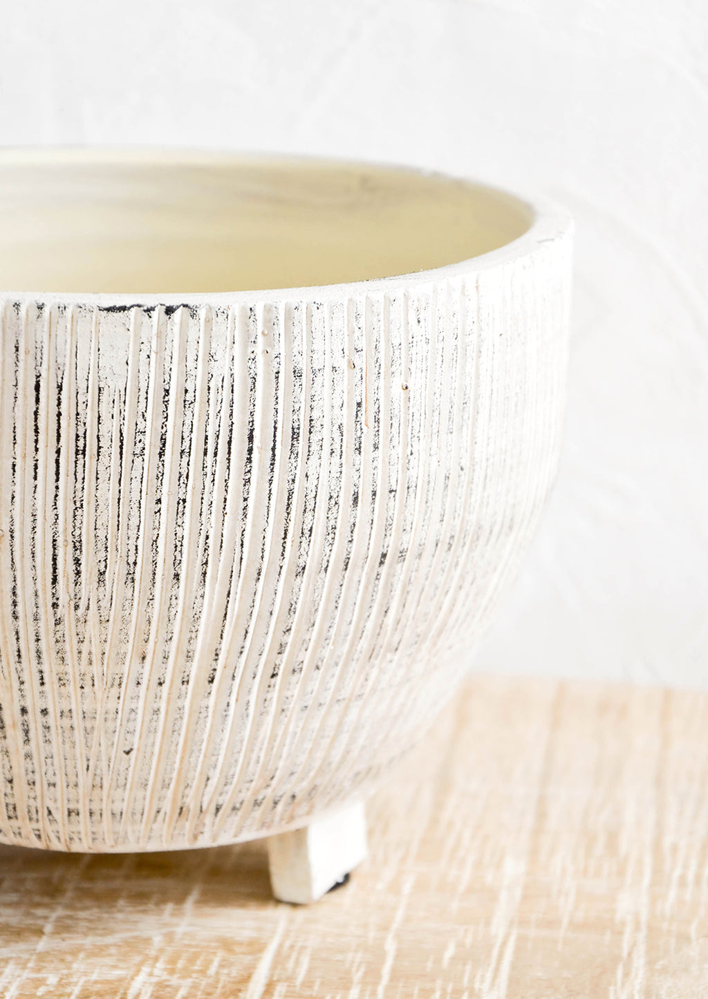 2: Ceramic planter with distressed, ribbed texture in white and black