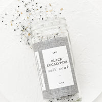 Black Eucalyptus: Bath salt soak spilling out of a glass jar.