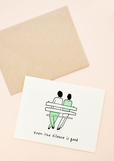 "Greeting card with couple sitting on a bench. Text reads ""Even the silence is good"""