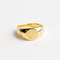 "1: Shiny gold ring with flat signet front with the words ""Everything will be ok"" etched into and decorative etched markings around a wide band."