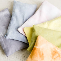 5: An assortment of relaxation eye pillows in a naturally dyed, rainbow span of colors.