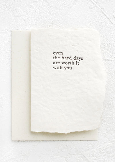 "A greeting card made from handmade paper and text on front reads ""Even the hard days are worth it with you""."
