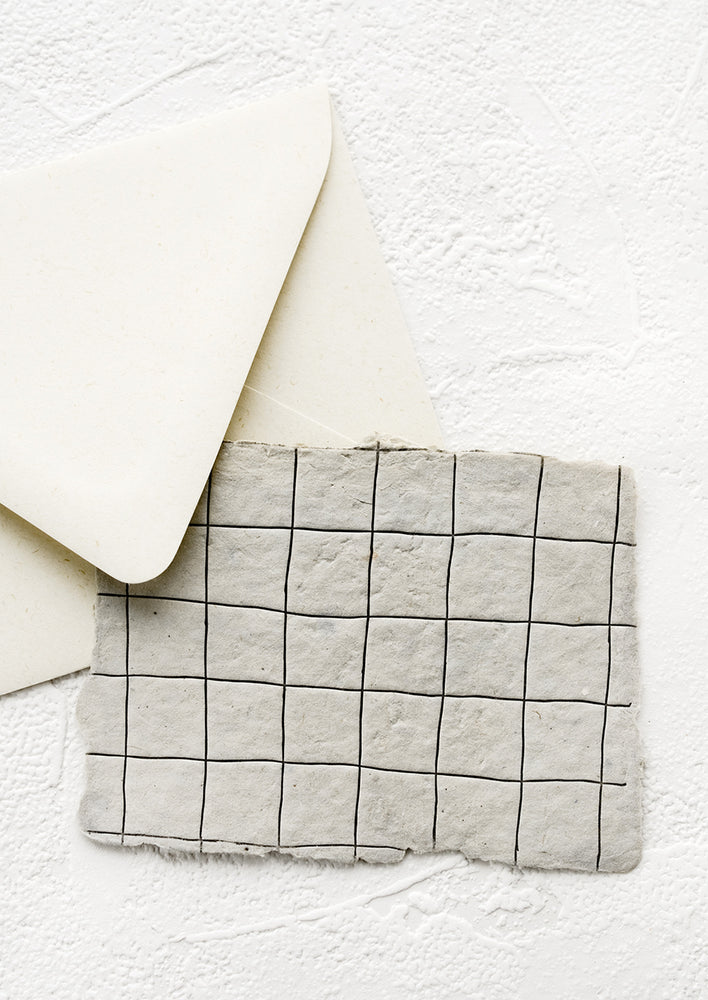 2: A greeting card made from handmade paper with a letterpress printed grid pattern.