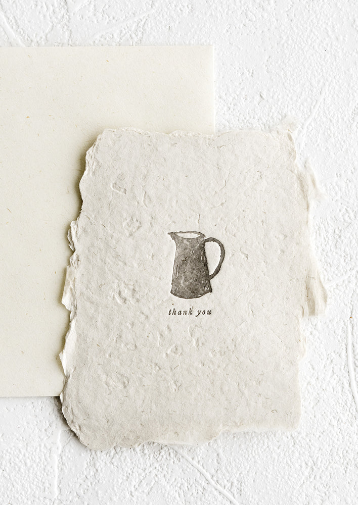 1: A notecard made from deckled edge handmade paper with image of a pitcher.