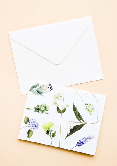 White greeting card with botanical pattern. Shown with white envelope.