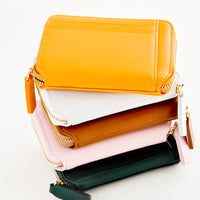 3: Stack of colorful leather zip wallets.