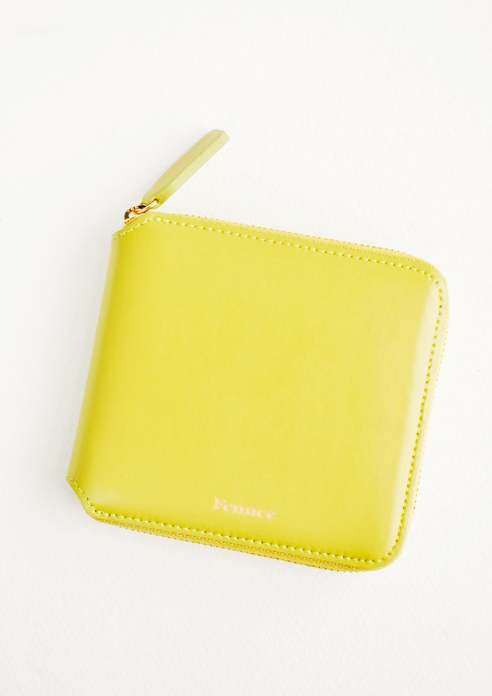 Chartreuse: Chartreuse leather wallet that zips on three sides, with matching tab pull.