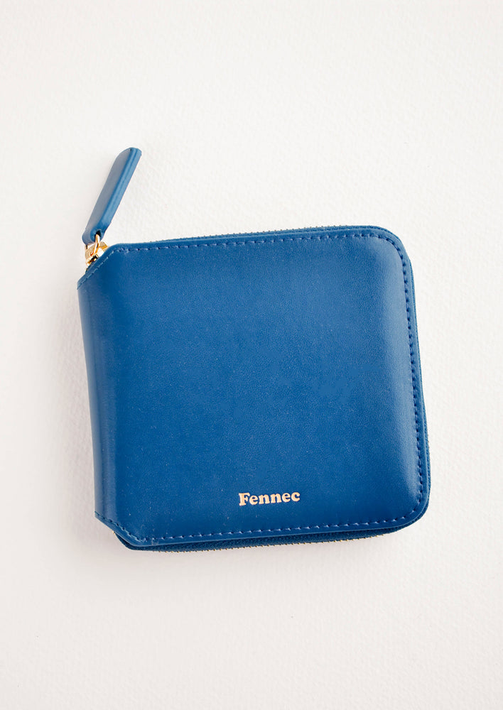 Deep Blue: Dark blue leather wallet that zips on three sides, with matching tab pull.