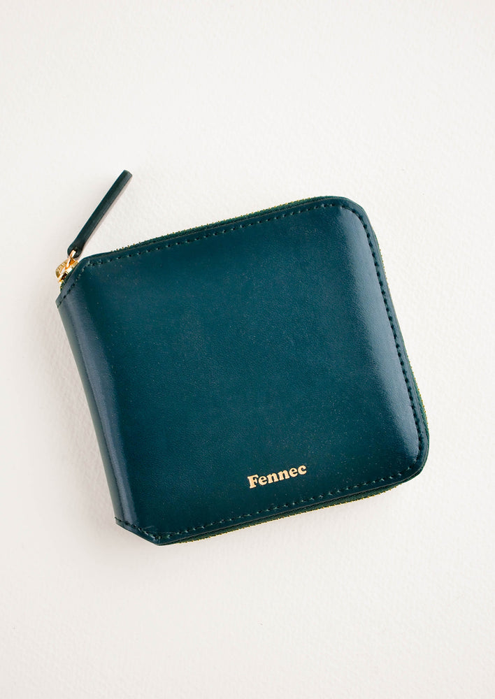 Sea Green: Dark green leather wallet that zips on three sides, with matching tab pull.