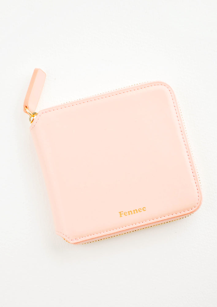 Peach: Light pink leather wallet that zips on three sides, with matching tab pull.