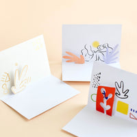 2: Insides of three notecards featuring cut out, pop up paper detail.