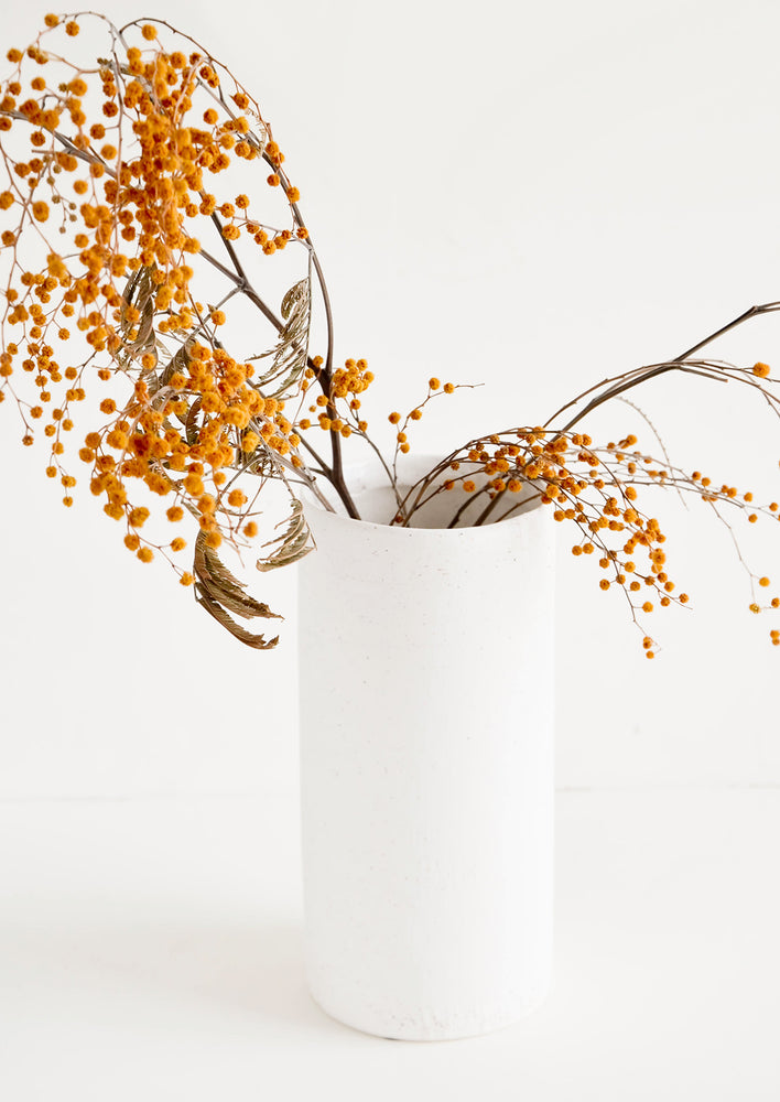 Tall [$32.00]: Tall and narrow cylindrical vase in white concrete material, displaying dried mimosa