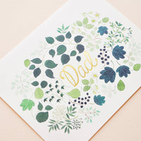 "2: Greeting card with green floral print frame around ""Dad"" printed in gold text"