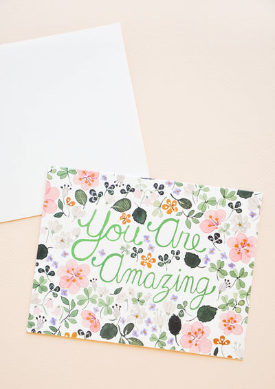 "Greeting card with allover floral print and text reading ""You Are Amazing"""
