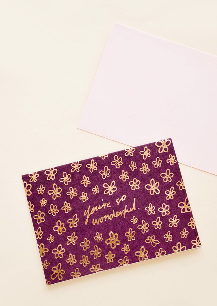 "1: Greeting card with hand drawn copper flowers all over. Text at center reads ""You're so wonderful""."