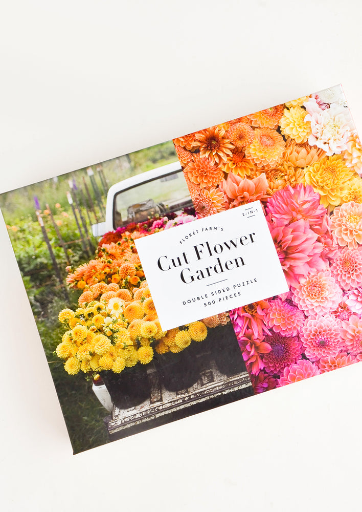 1: Photographic printed box containing a floral themed jigsaw puzzle