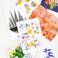 2: Product shot showing multiple styles of floral postcards.