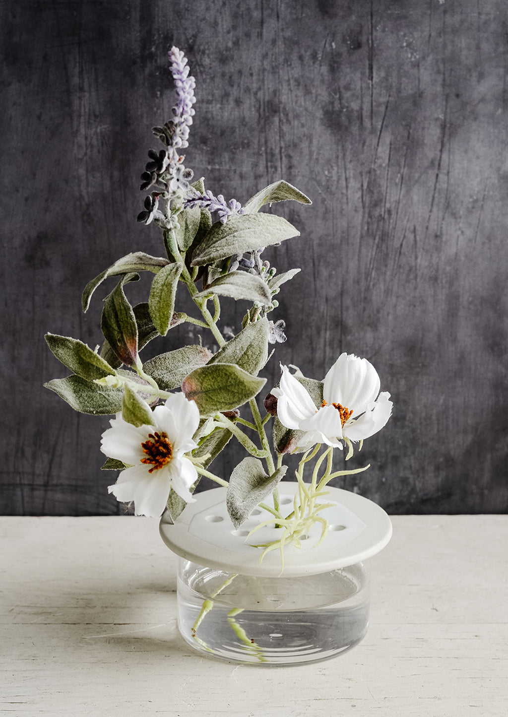 Short: A short ceramic and glass flower frog with lavender and cosmos.