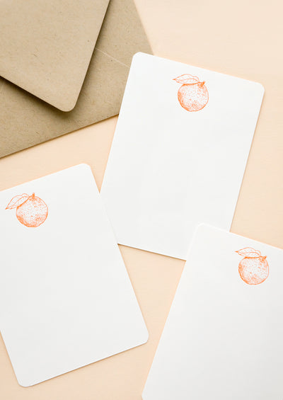 Set of flat white notecards with single orange printed at top