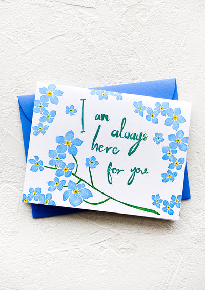 "Greeting card with blue flowers and green cursive text reading ""I am always here for you"""
