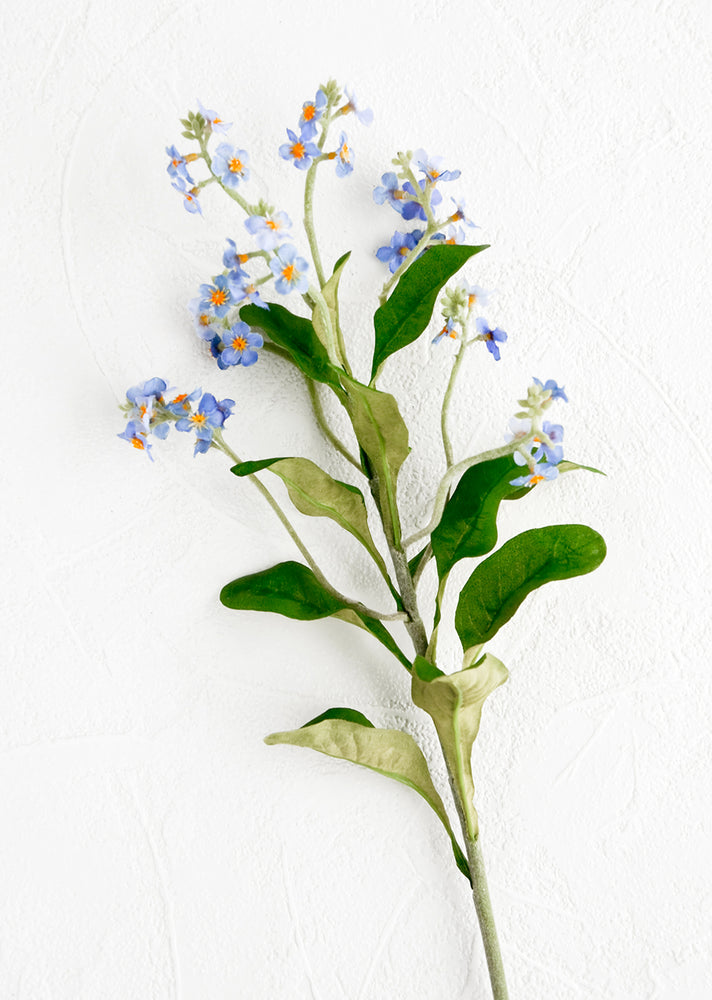 1: A realistic looking faux flower stem made to look like forget me not.