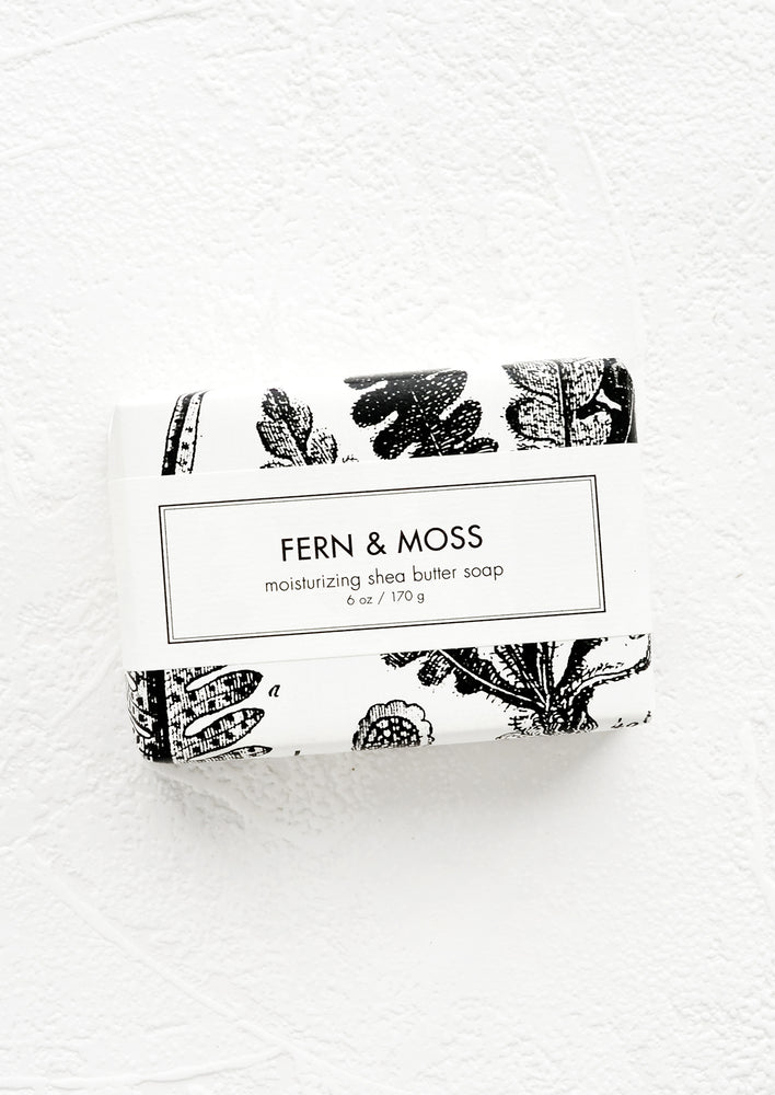 Fern & Moss: A bar of soap in black & white botanical graphic packaging.