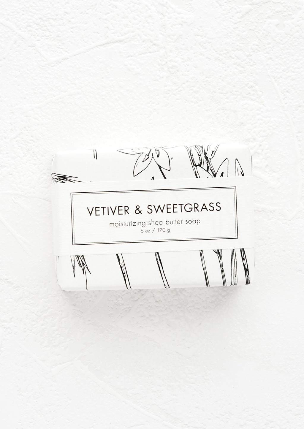 Vetiver & Sweetgrass: A bar of soap in black & white botanical graphic packaging.