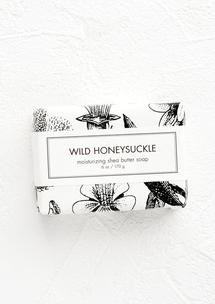 Wild Honeysuckle: A bar of soap in black & white botanical graphic packaging.
