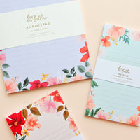 1: Product show showing three sizes of floral notepad.