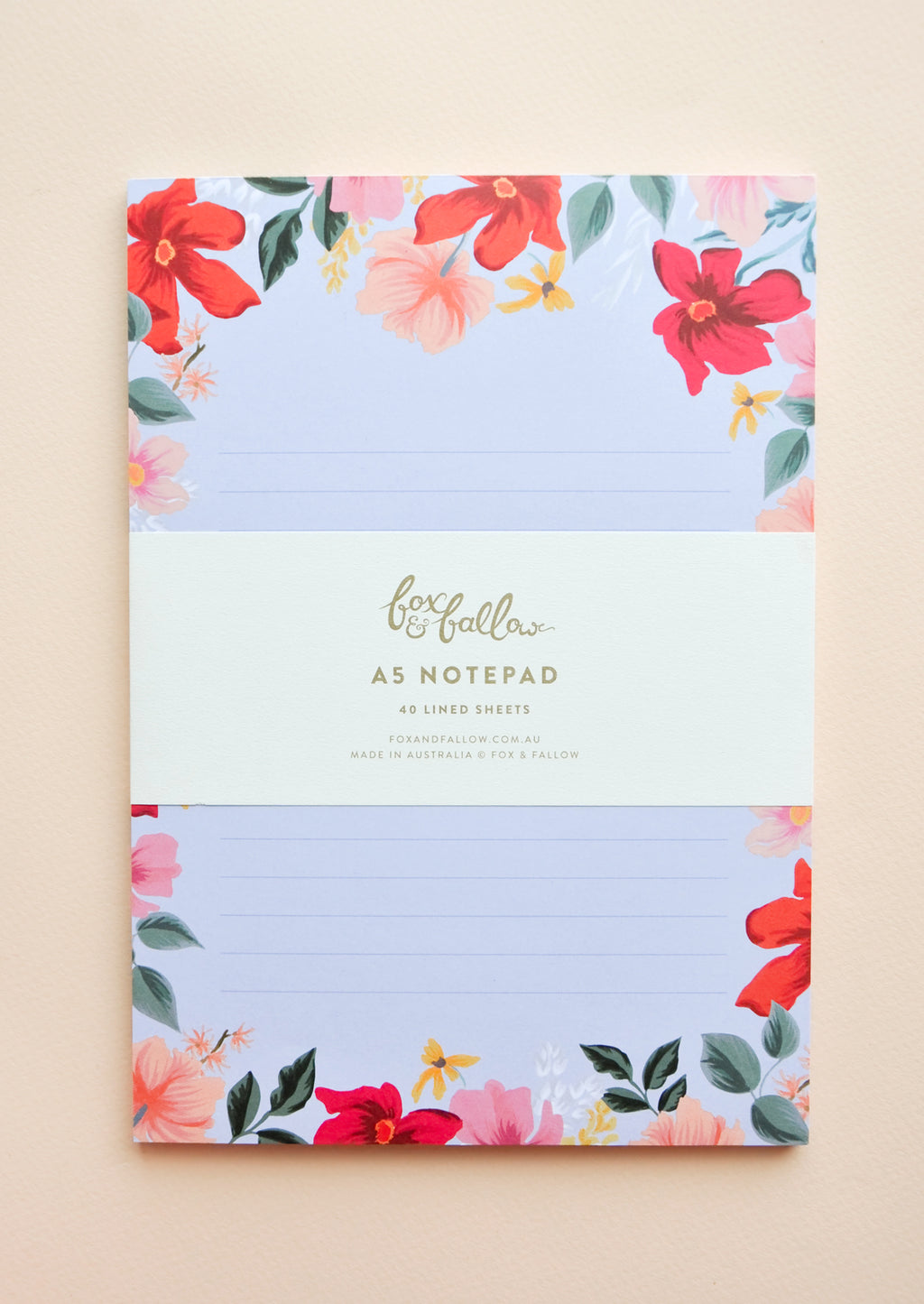 Large / Periwinkle: Large notepad with lined blue paper and floral decoration.