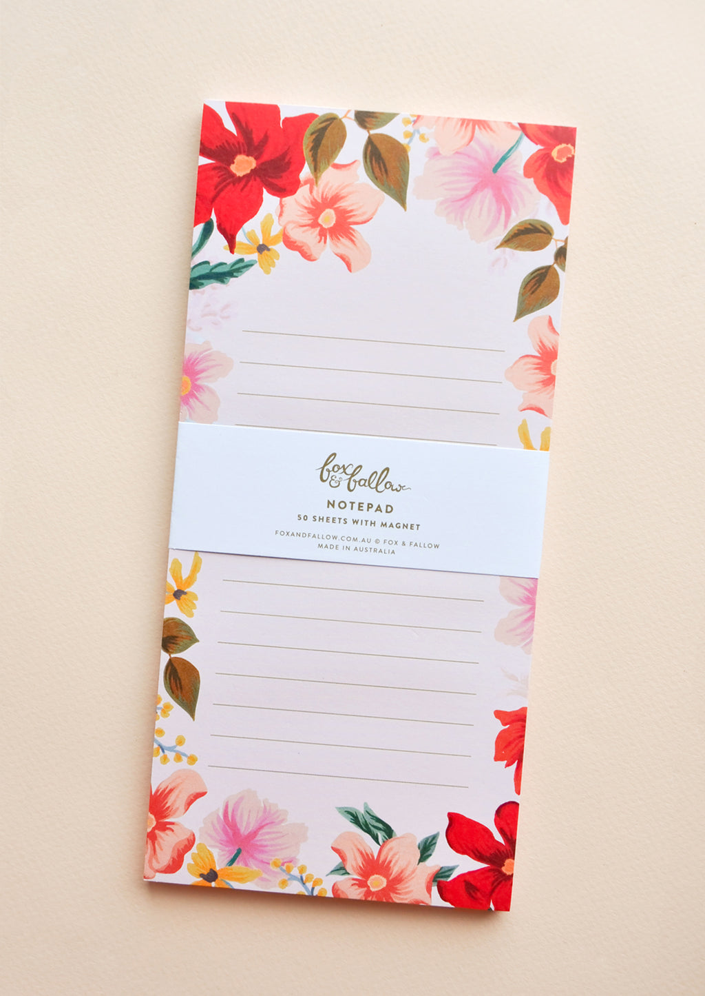Medium / Blush: Medium notepad with lined pink paper and floral decoration.