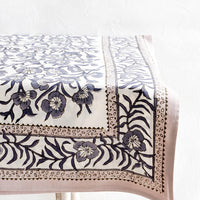 2: Tablecloth featuring bordered floral pattern displayed on a table.
