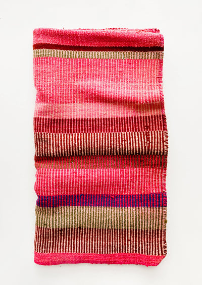 Vintage wool textile in striped pattern in a mix of pink, tan and purple