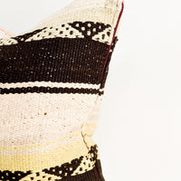 2: Square throw pillow in wool fabric with tan and black stripes, accents of orange and yellow.