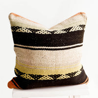 1: Square throw pillow in wool fabric with tan and black stripes, accents of orange and yellow.