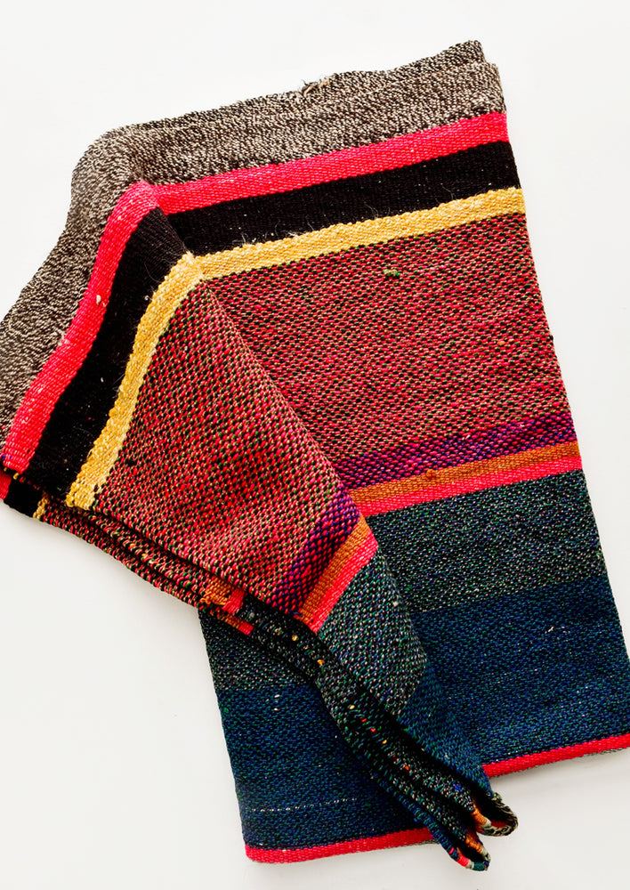 2: Vintage wool textile in striped pattern in a mix of blue, pink, black and yellow
