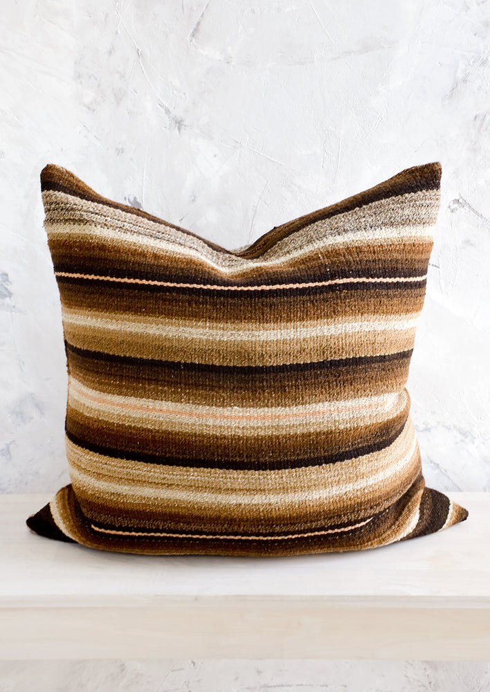 1: Throw pillow made from vintage wool fabric in brown, cream and peach stripes