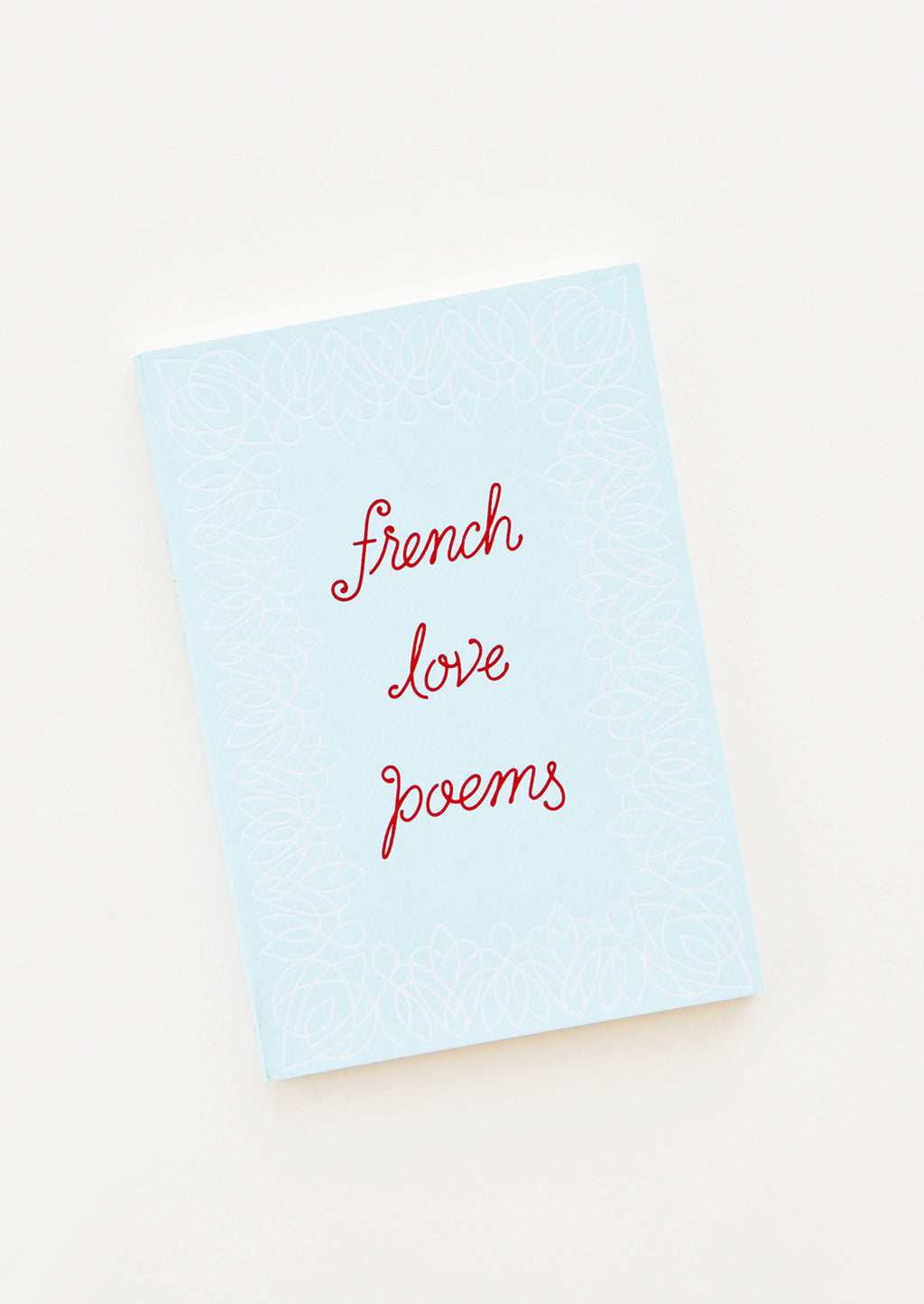 "1: Small blue book with red writing featuring the text ""french love poems""."