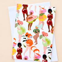 2: Greeting card featuring illustrated people of all skin colors, covering themselves with fruit.