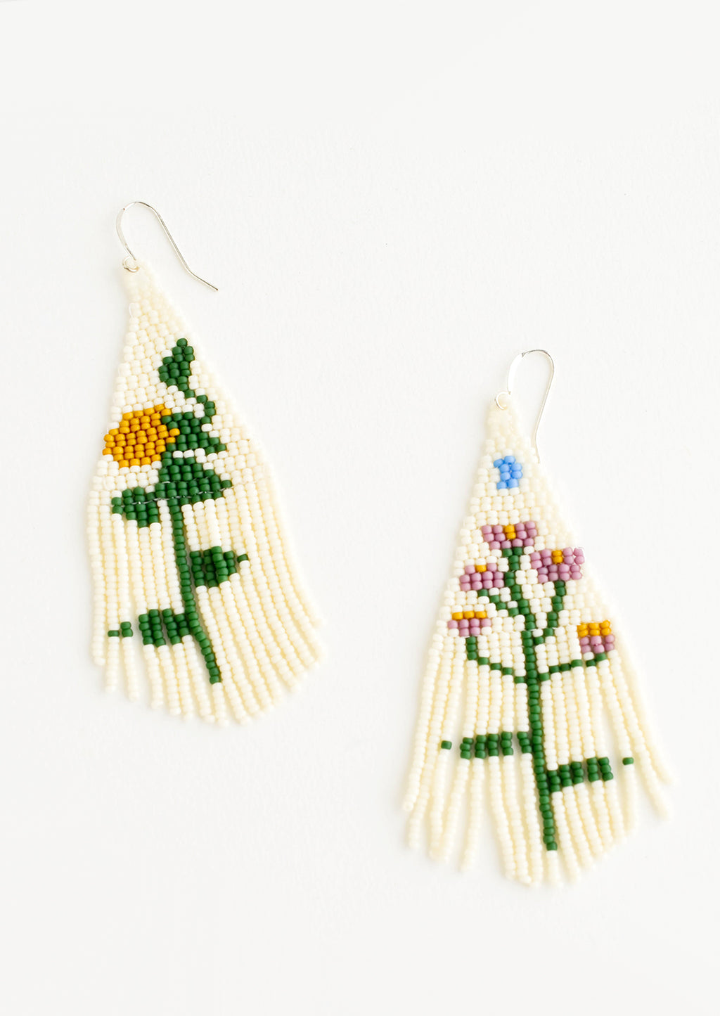 1: Cream colored beaded fringe earrings each depicting a different flower.