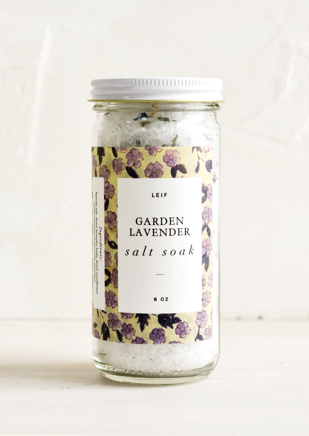 Garden Lavender: A straight sided glass jar containing Garden Lavender salt soak.