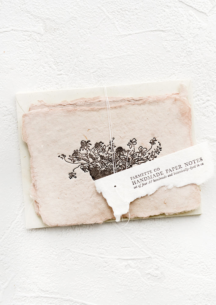1: A packaged set of cards made from handmade paper with a letterpress printed image of flowers in a bowl.
