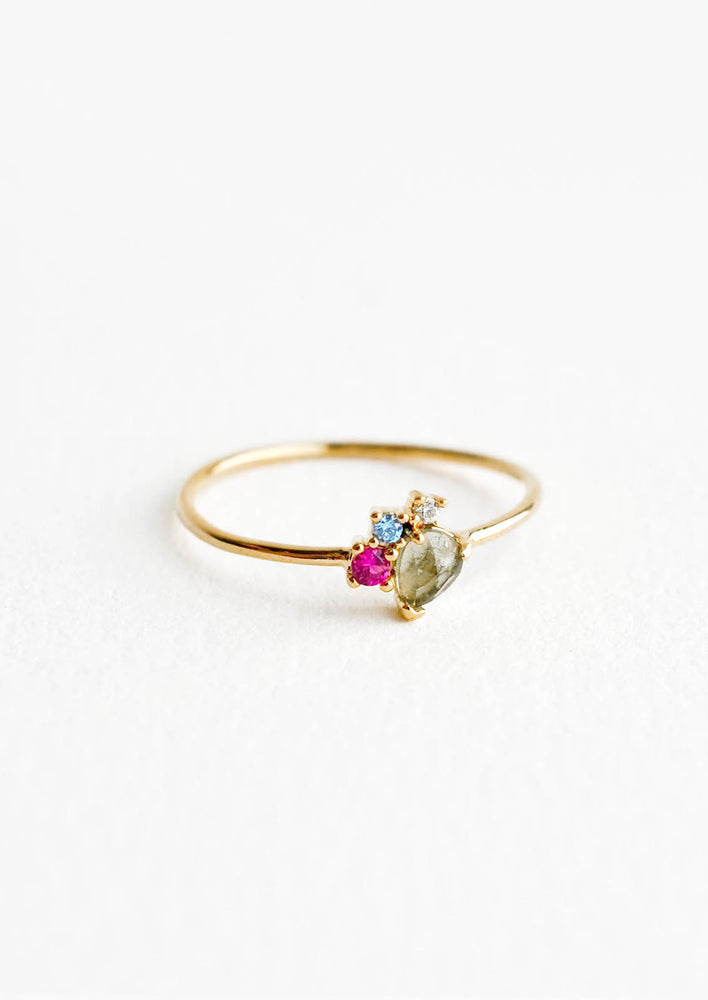 Grey Multi / Size 6: Gold ring featuring slim band with two gemstones and two crystals in pink, blue and grey hues, prong set in a cluster.