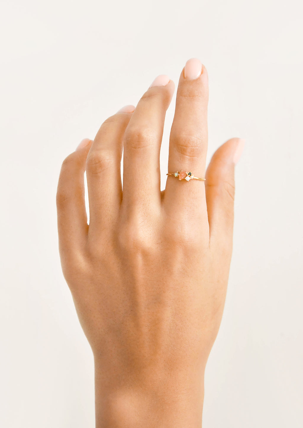 4: Model shot of hand wearing slim gold ring.
